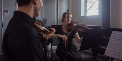 Capturing special moments like violin recital makes it more special with Posterboy Media's professional photography services