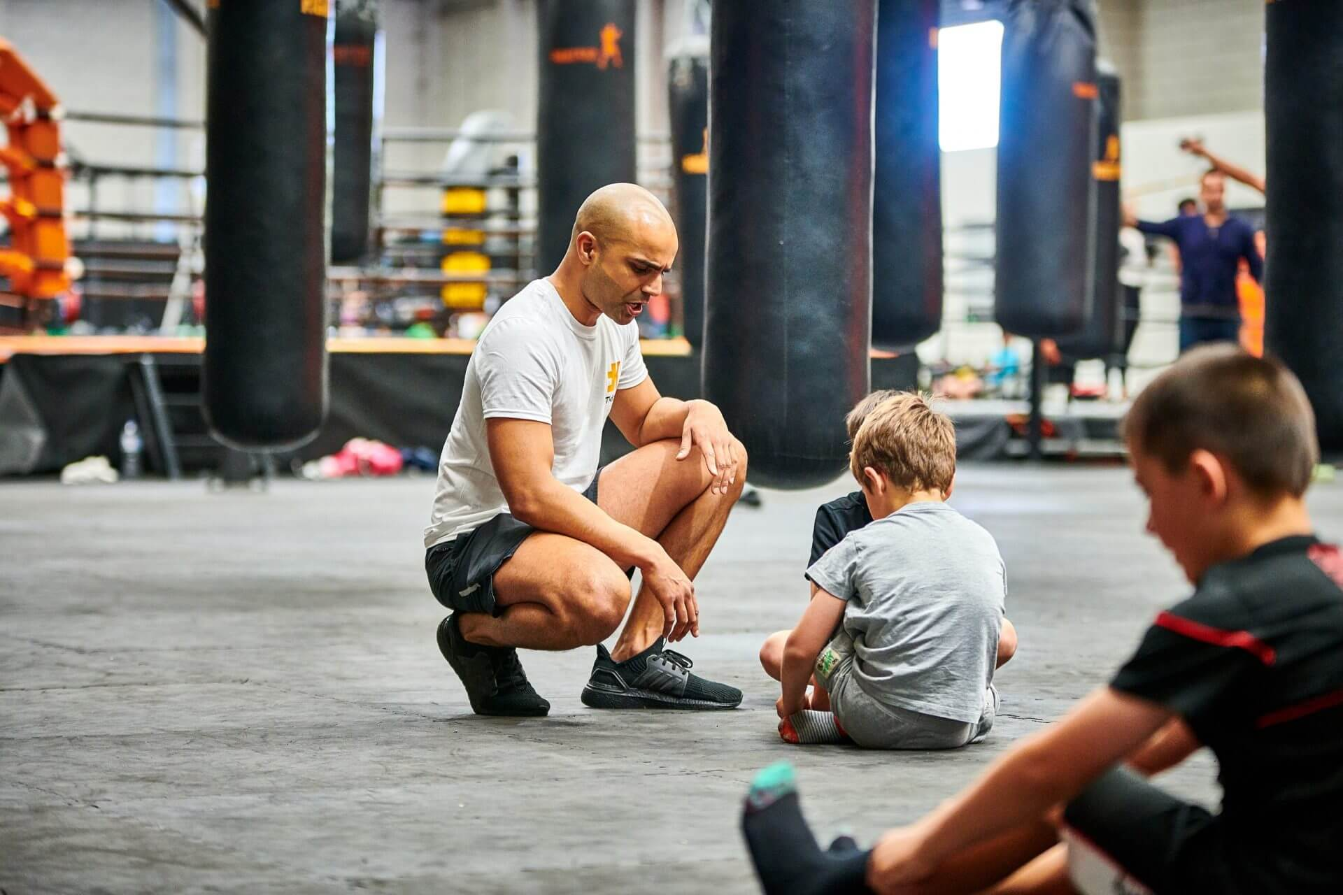 2 boys and a trainer means fun workout at FitKids