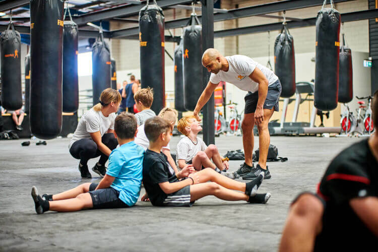 Kids and a trainor at FITKids enjoying their fitness classes.